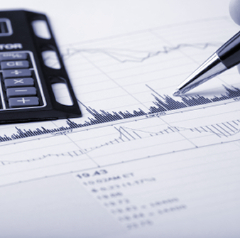 Stock price chart printout being analyzed. Pointing with a pen at chart features, with calculator ready.